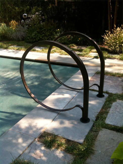 Blacksmith custom designed pool railing hand forged steel