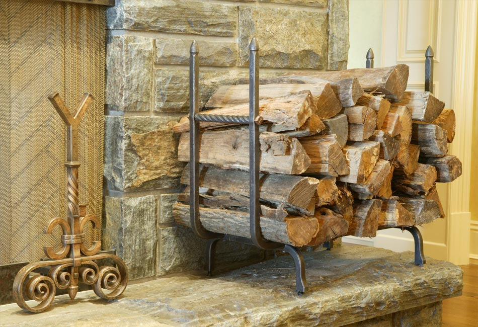 blacksmith custom designed fireplace log holder hand